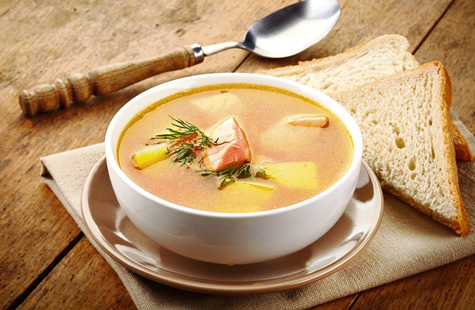 bowl of fish soup on wooden table